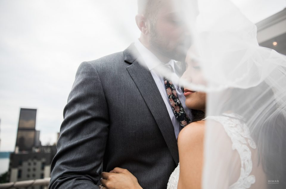 Seattle Multicultural Wedding First Look, Veil Blowing in Wind at Hotel Sorento Rooftop by DIWAS Photography
