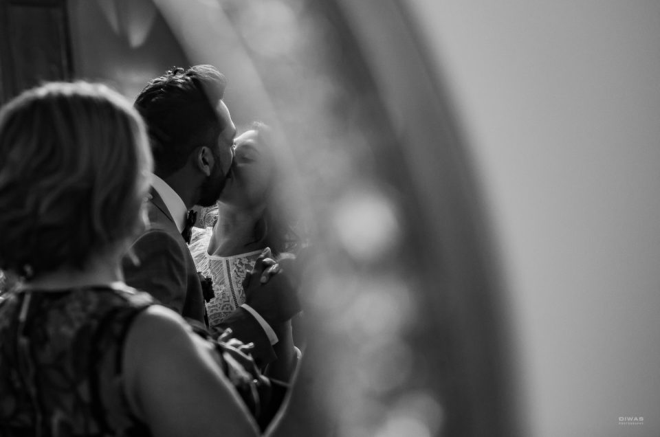 Relaxed Lake Washington wedding candid black and white photograph of ceremony kiss